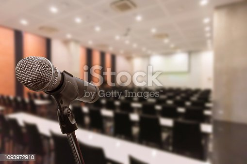 istock Microphone over the blurred business forum Meeting or Conference Training Learning Coaching Room Concept, Blurred background. 1093972910