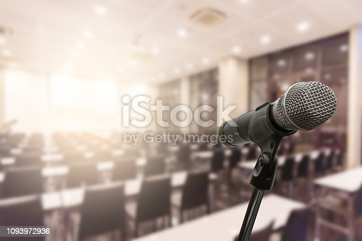 istock Microphone over the blurred business forum Meeting or Conference Training Learning Coaching Room Concept, Blurred background. 1093972936