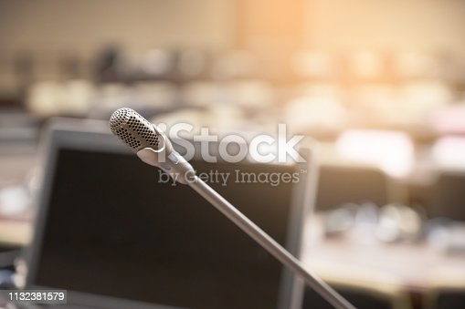 istock Microphone over the blurred business forum Meeting or Conference Training Learning Coaching Room Concept, Blurred background. 1132381579