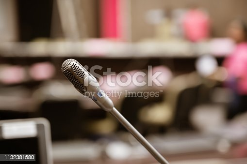 istock Microphone over the blurred business forum Meeting or Conference Training Learning Coaching Room Concept, Blurred background. 1132381580