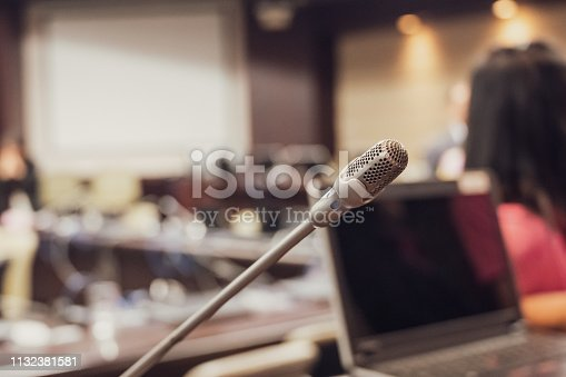 istock Microphone over the blurred business forum Meeting or Conference Training Learning Coaching Room Concept, Blurred background. 1132381581