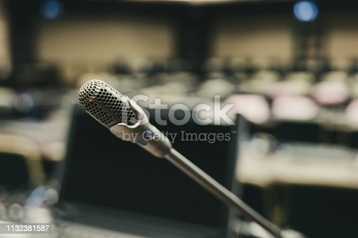 istock Microphone over the blurred business forum Meeting or Conference Training Learning Coaching Room Concept, Blurred background. 1132381587