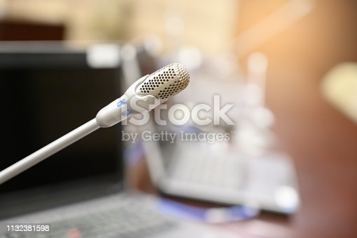 1132381614istockphoto Microphone over the blurred business forum Meeting or Conference Training Learning Coaching Room Concept, Blurred background. 1132381598