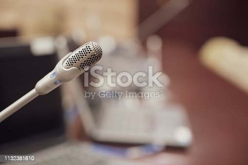 istock Microphone over the blurred business forum Meeting or Conference Training Learning Coaching Room Concept, Blurred background. 1132381610