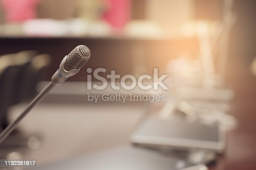 1132381614istockphoto Microphone over the blurred business forum Meeting or Conference Training Learning Coaching Room Concept, Blurred background. 1132381617