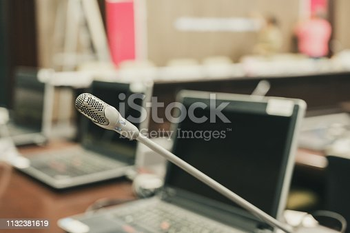 istock Microphone over the blurred business forum Meeting or Conference Training Learning Coaching Room Concept, Blurred background. 1132381619
