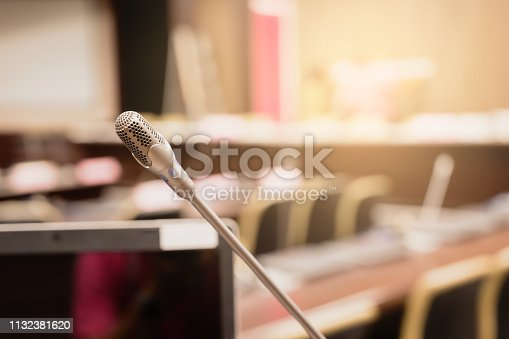 istock Microphone over the blurred business forum Meeting or Conference Training Learning Coaching Room Concept, Blurred background. 1132381620