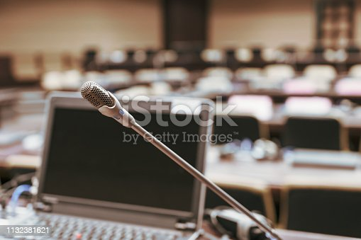 istock Microphone over the blurred business forum Meeting or Conference Training Learning Coaching Room Concept, Blurred background. 1132381621