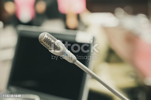 istock Microphone over the blurred business forum Meeting or Conference Training Learning Coaching Room Concept, Blurred background. 1132381648
