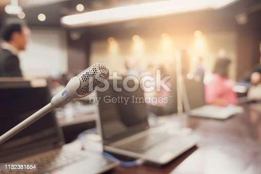 istock Microphone over the blurred business forum Meeting or Conference Training Learning Coaching Room Concept, Blurred background. 1132381654