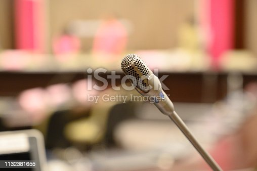 istock Microphone over the blurred business forum Meeting or Conference Training Learning Coaching Room Concept, Blurred background. 1132381655