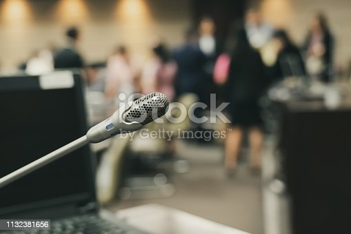 istock Microphone over the blurred business forum Meeting or Conference Training Learning Coaching Room Concept, Blurred background. 1132381656