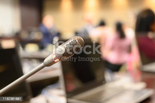 1132381614istockphoto Microphone over the blurred business forum Meeting or Conference Training Learning Coaching Room Concept, Blurred background. 1132381661
