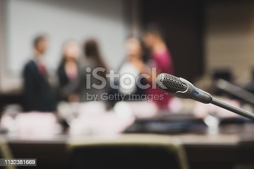 istock Microphone over the blurred business forum Meeting or Conference Training Learning Coaching Room Concept, Blurred background. 1132381669