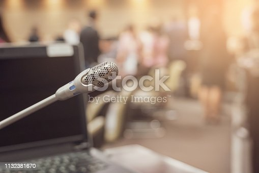 istock Microphone over the blurred business forum Meeting or Conference Training Learning Coaching Room Concept, Blurred background. 1132381670