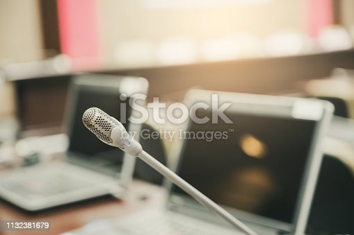 istock Microphone over the blurred business forum Meeting or Conference Training Learning Coaching Room Concept, Blurred background. 1132381679