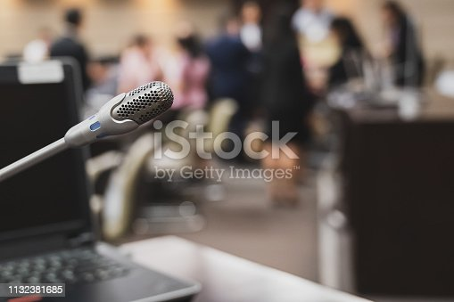 1132381614istockphoto Microphone over the blurred business forum Meeting or Conference Training Learning Coaching Room Concept, Blurred background. 1132381685