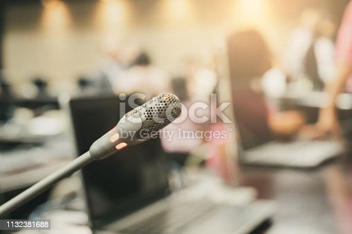istock Microphone over the blurred business forum Meeting or Conference Training Learning Coaching Room Concept, Blurred background. 1132381688