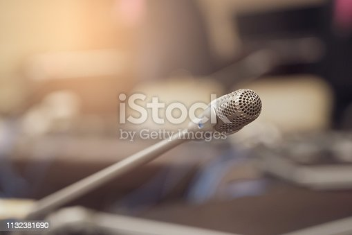 istock Microphone over the blurred business forum Meeting or Conference Training Learning Coaching Room Concept, Blurred background. 1132381690