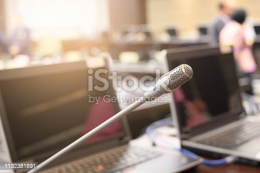 1132381614istockphoto Microphone over the blurred business forum Meeting or Conference Training Learning Coaching Room Concept, Blurred background. 1132381691