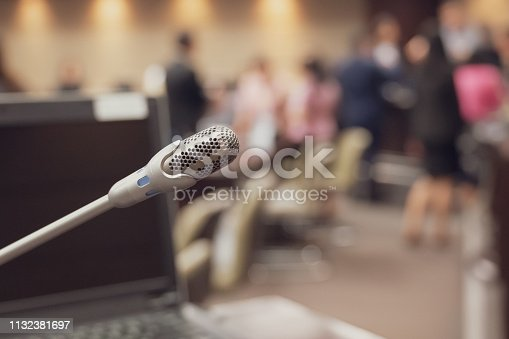 istock Microphone over the blurred business forum Meeting or Conference Training Learning Coaching Room Concept, Blurred background. 1132381697