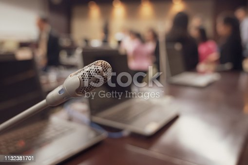 istock Microphone over the blurred business forum Meeting or Conference Training Learning Coaching Room Concept, Blurred background. 1132381701