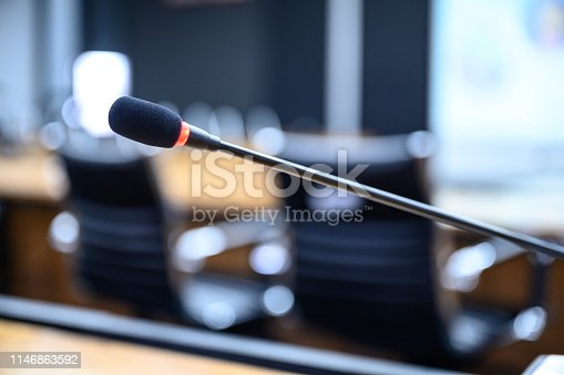 814301186 istock photo Microphone over the blurred business forum Meeting or Conference Training Learning Coaching Room Concept, Blurred background. 1146863592