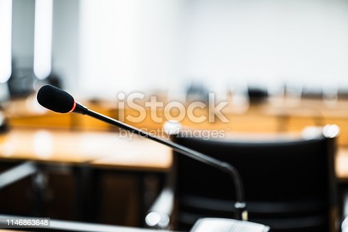 814301186istockphoto Microphone over the blurred business forum Meeting or Conference Training Learning Coaching Room Concept, Blurred background. 1146863648