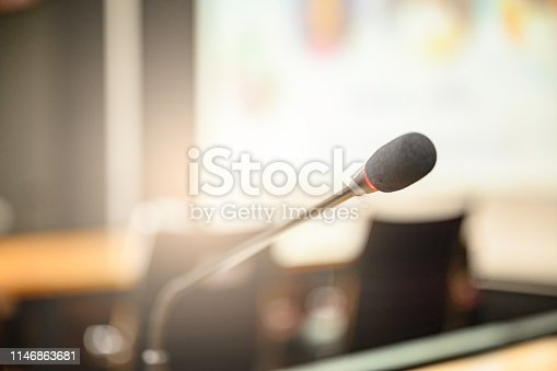 814301186 istock photo Microphone over the blurred business forum Meeting or Conference Training Learning Coaching Room Concept, Blurred background. 1146863681