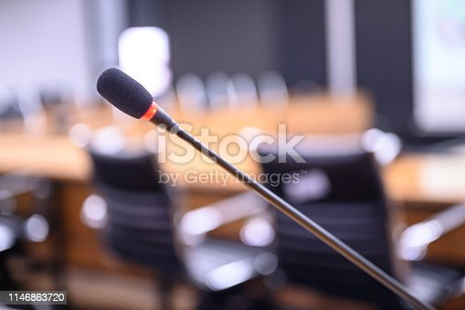 814301186 istock photo Microphone over the blurred business forum Meeting or Conference Training Learning Coaching Room Concept, Blurred background. 1146863720