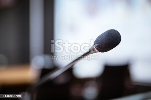 814301186istockphoto Microphone over the blurred business forum Meeting or Conference Training Learning Coaching Room Concept, Blurred background. 1146863788
