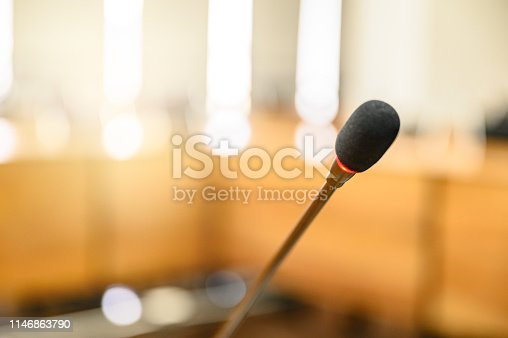 814301186 istock photo Microphone over the blurred business forum Meeting or Conference Training Learning Coaching Room Concept, Blurred background. 1146863790
