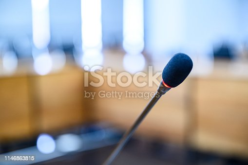 831720990istockphoto Microphone over the blurred business forum Meeting or Conference Training Learning Coaching Room Concept, Blurred background. 1146863815