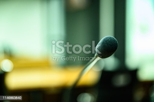 814301186 istock photo Microphone over the blurred business forum Meeting or Conference Training Learning Coaching Room Concept, Blurred background. 1146863840