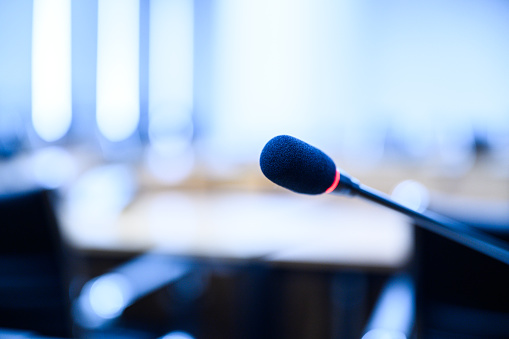 831720990 istock photo Microphone over the blurred business forum Meeting or Conference Training Learning Coaching Room Concept, Blurred background. 1146863841