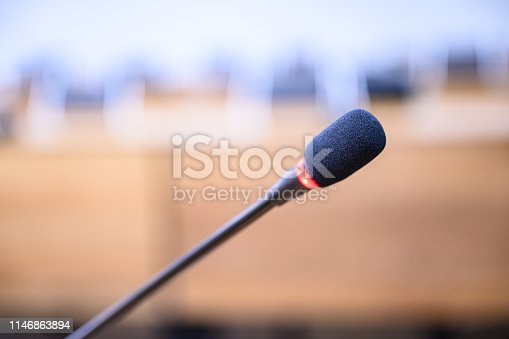 814301186 istock photo Microphone over the blurred business forum Meeting or Conference Training Learning Coaching Room Concept, Blurred background. 1146863894