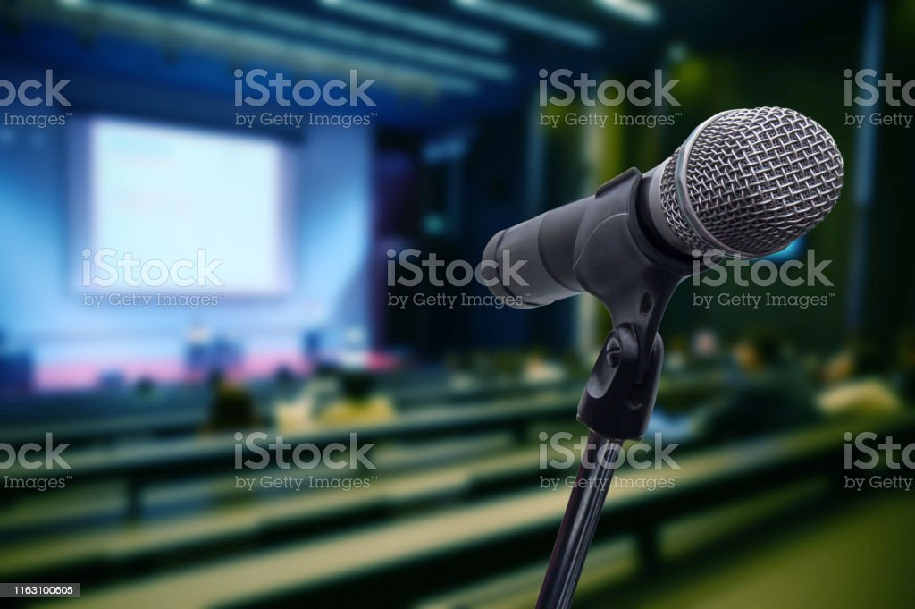 Microphone over the blurred business forum Meeting or Conference...