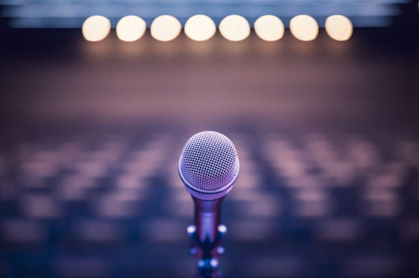 Microphone over the blurred business forum Meeting or Conference Room Concept, Blurred background. Microphone over the blurred business forum Meeting or Conference Room Concept, Blurred background. debate stock pictures, royalty-free photos & images