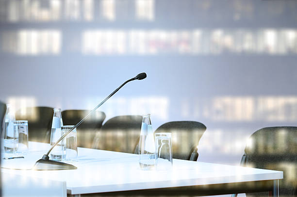 Microphone ready, allset for conference to begin. Business building reflection stock photo