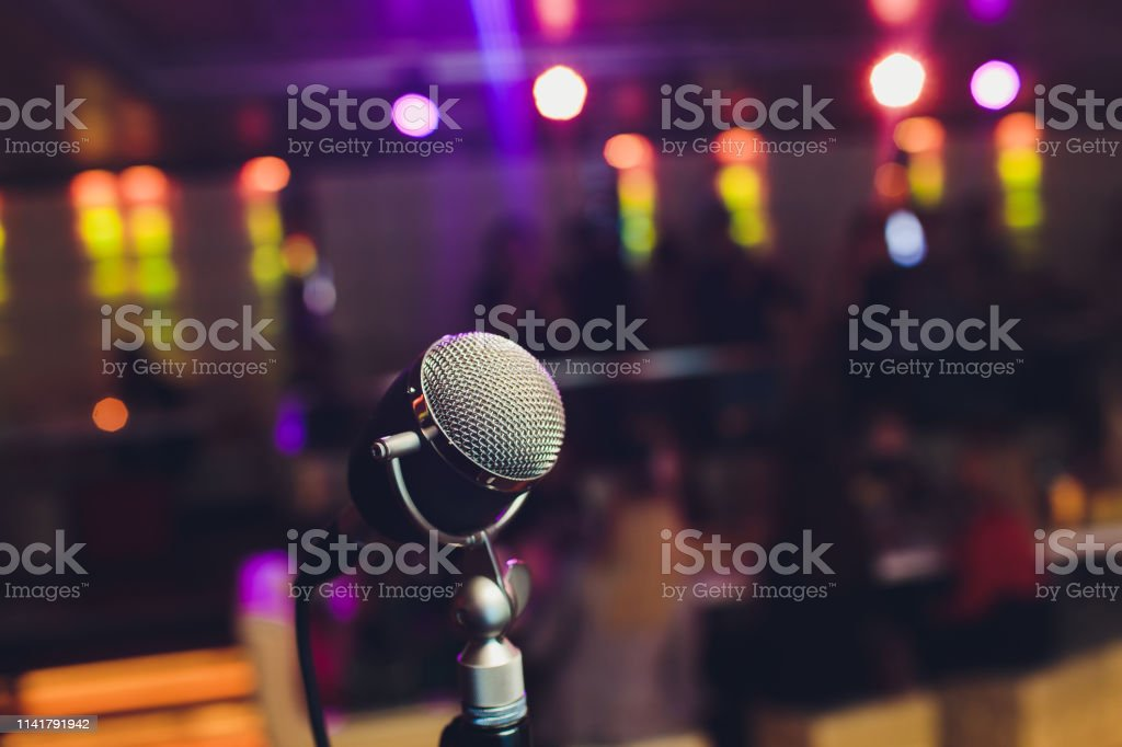 Microphone. Retro microphone. A microphone on stage. A pub. Bar....