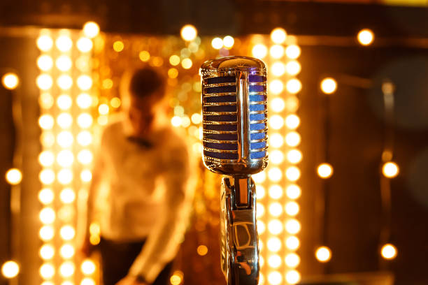 Microphone. Retro microphone. A microphone on stage. A pub. Bar. Restaurant. Classic. Evening. Night show. European restaurant. stock photo