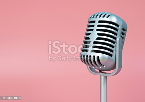 istock Microphone retro with copy space on pink background 1210691878