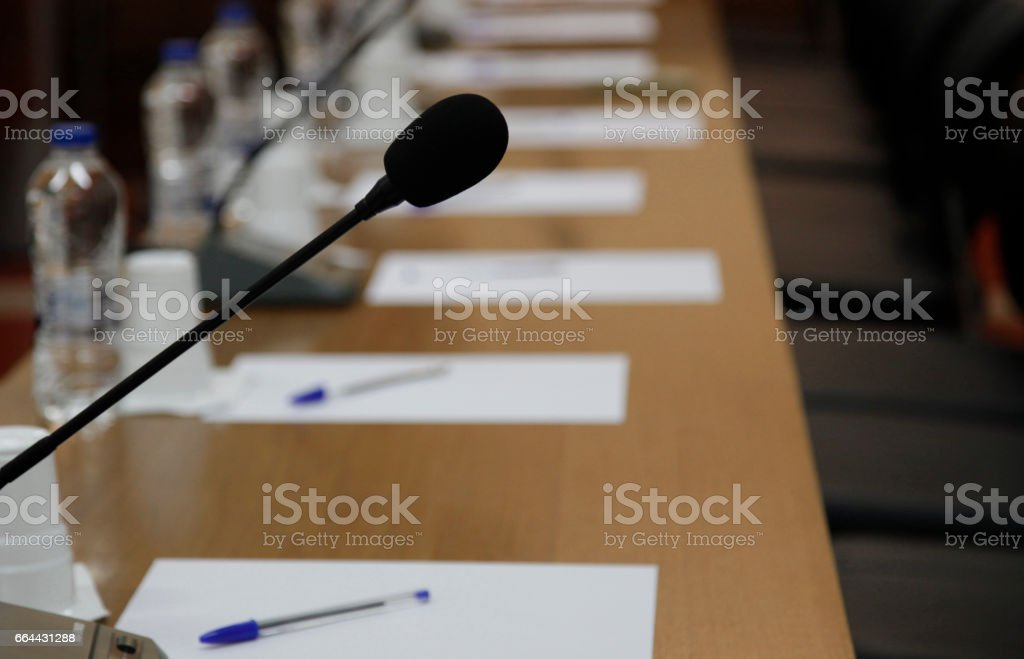 microphone speaker in boardroom bearings and chairs stock photo