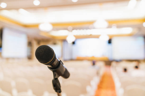Microphone stand in conference hall. Public announcement event, Organization company meeting, or graduation award ceremony concept Microphone stand in conference hall. Public announcement event, Organization company meeting, or graduation award ceremony concept debate stock pictures, royalty-free photos & images