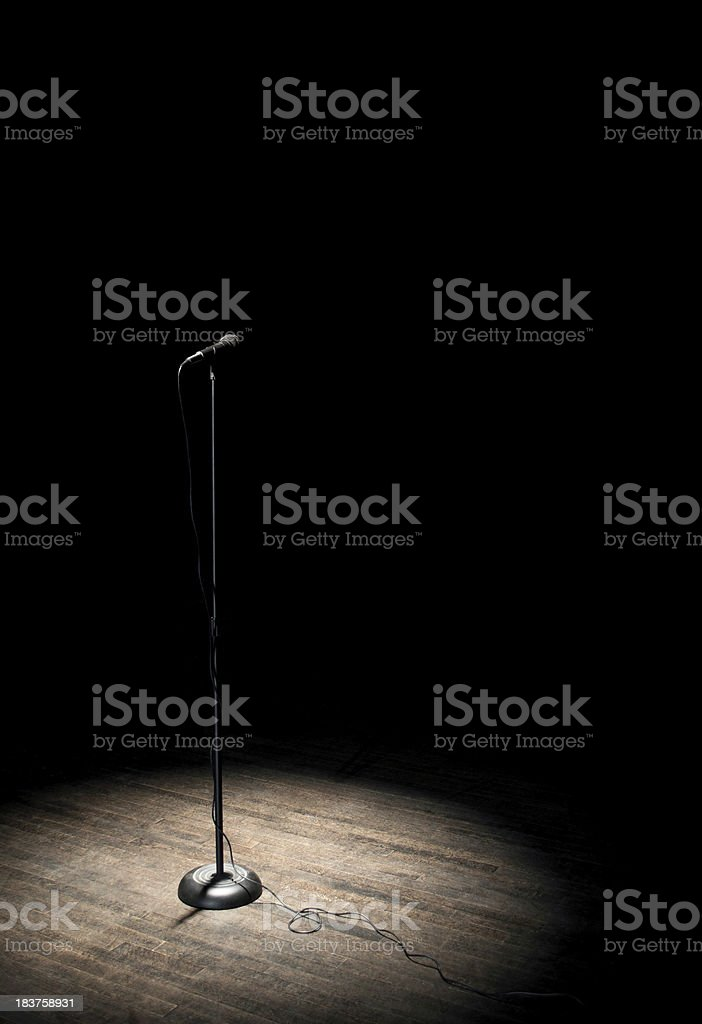 microphone under spotlight stock photo