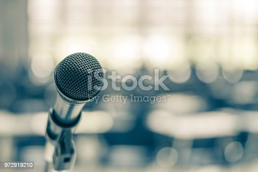 istock Microphone voice speaker in school lecture hall, seminar meeting room or educational business conference event for host, teacher or coaching mentor 972919210