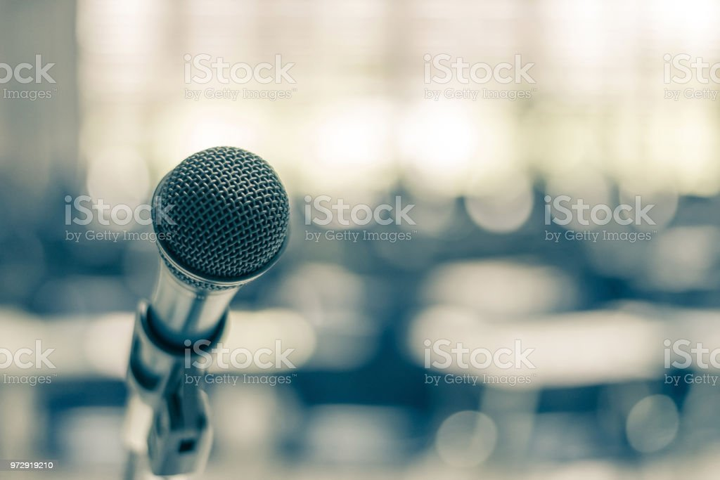 Microphone voice speaker in school lecture hall, seminar meeting room or educational business conference event for host, teacher or coaching mentor stock photo