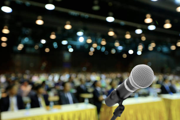 microphone voice speaker with audiences or students in seminar classroom, lecture hall or conference meeting in educational business event for host, teacher, or coaching mentor. - guest stock pictures, royalty-free photos & images