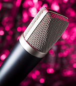 istock Microphone with a pink background 915670090