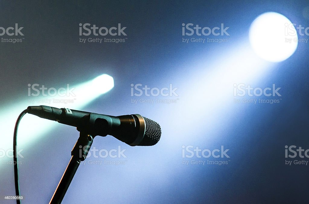 microphone with blue lights light bokeh  two illuminated royalty-free stock photo